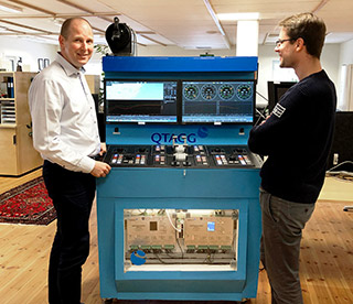Qtagg CEO Tomas Lindqvist and Design Engineer Niclas Rasmusson next to Qtagg test rig.